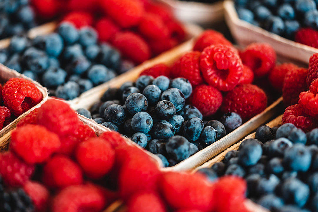 Download Organic Raspberries and Blueberries on a Farmers Market FREE Stock Photo