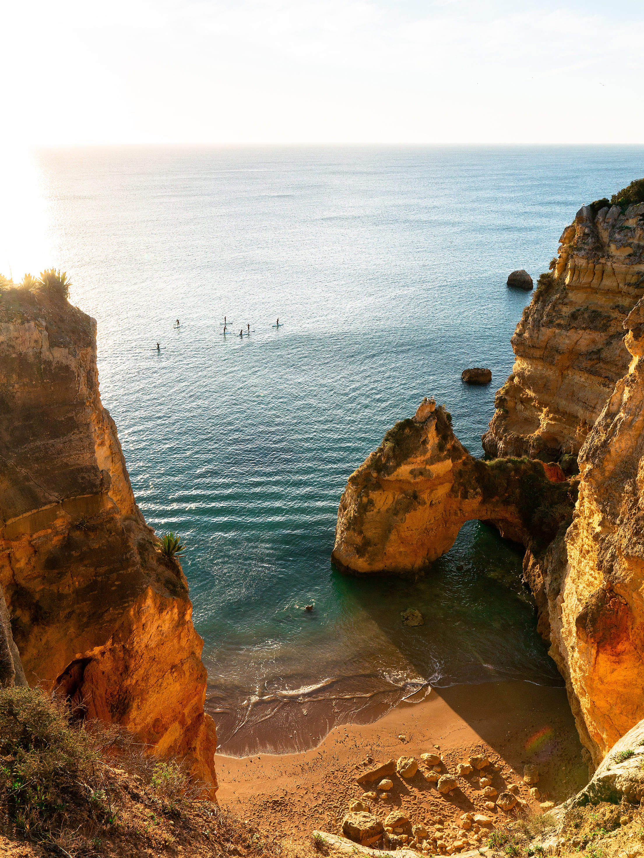 Paddleboarding Between Sea Pillars of Southern Portugal Free Stock Photo