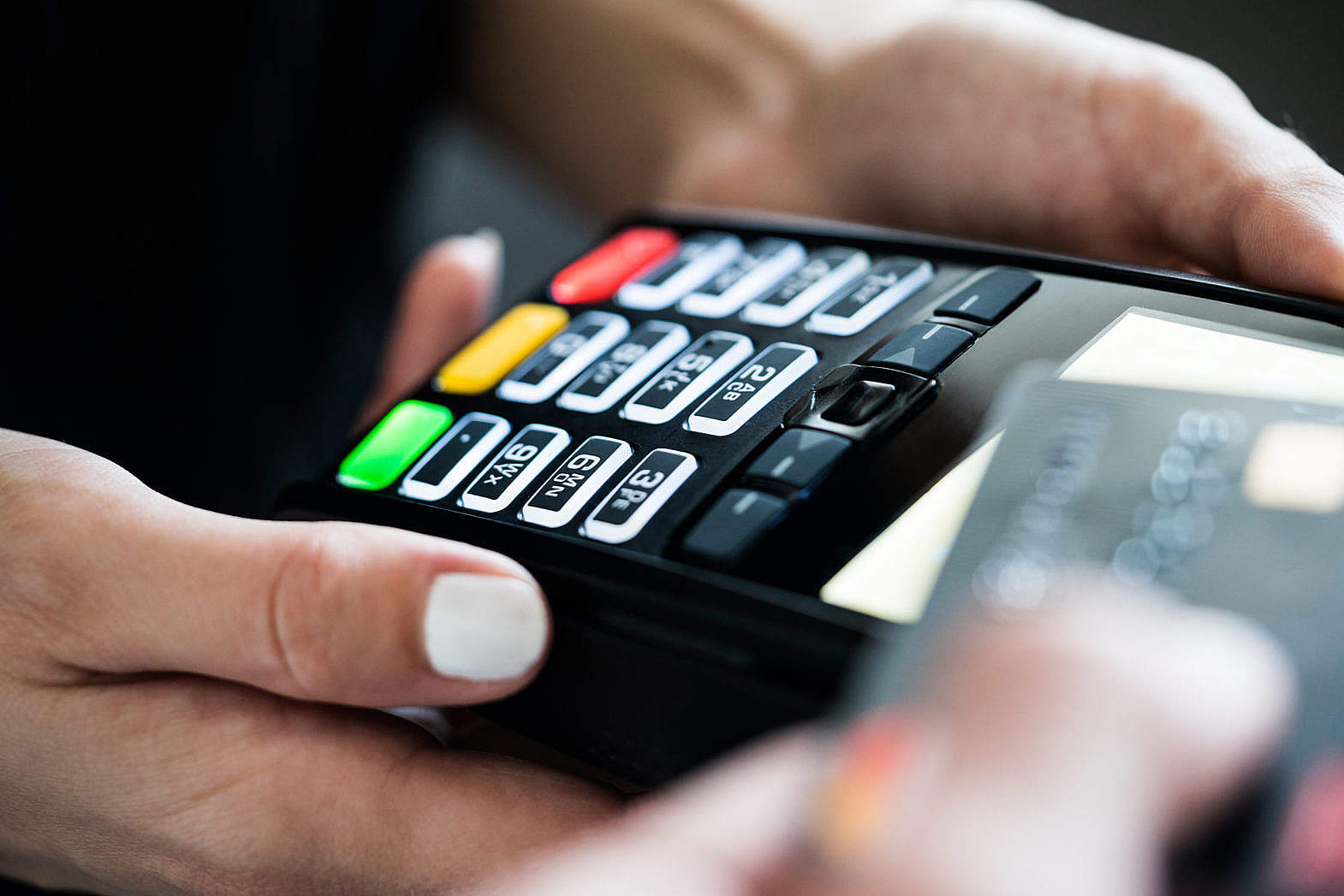 Retail Store Business Owner using Credit Card Terminal Free Stock Photo Download