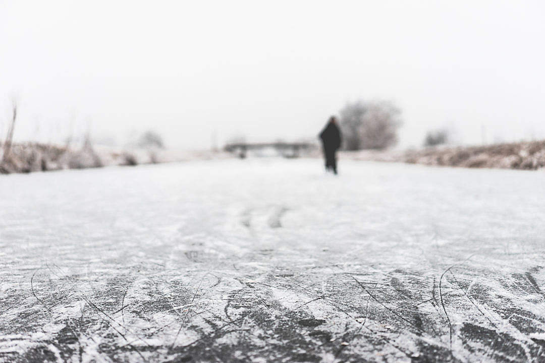 Download People Ice Skate on a Frozen River FREE Stock Photo