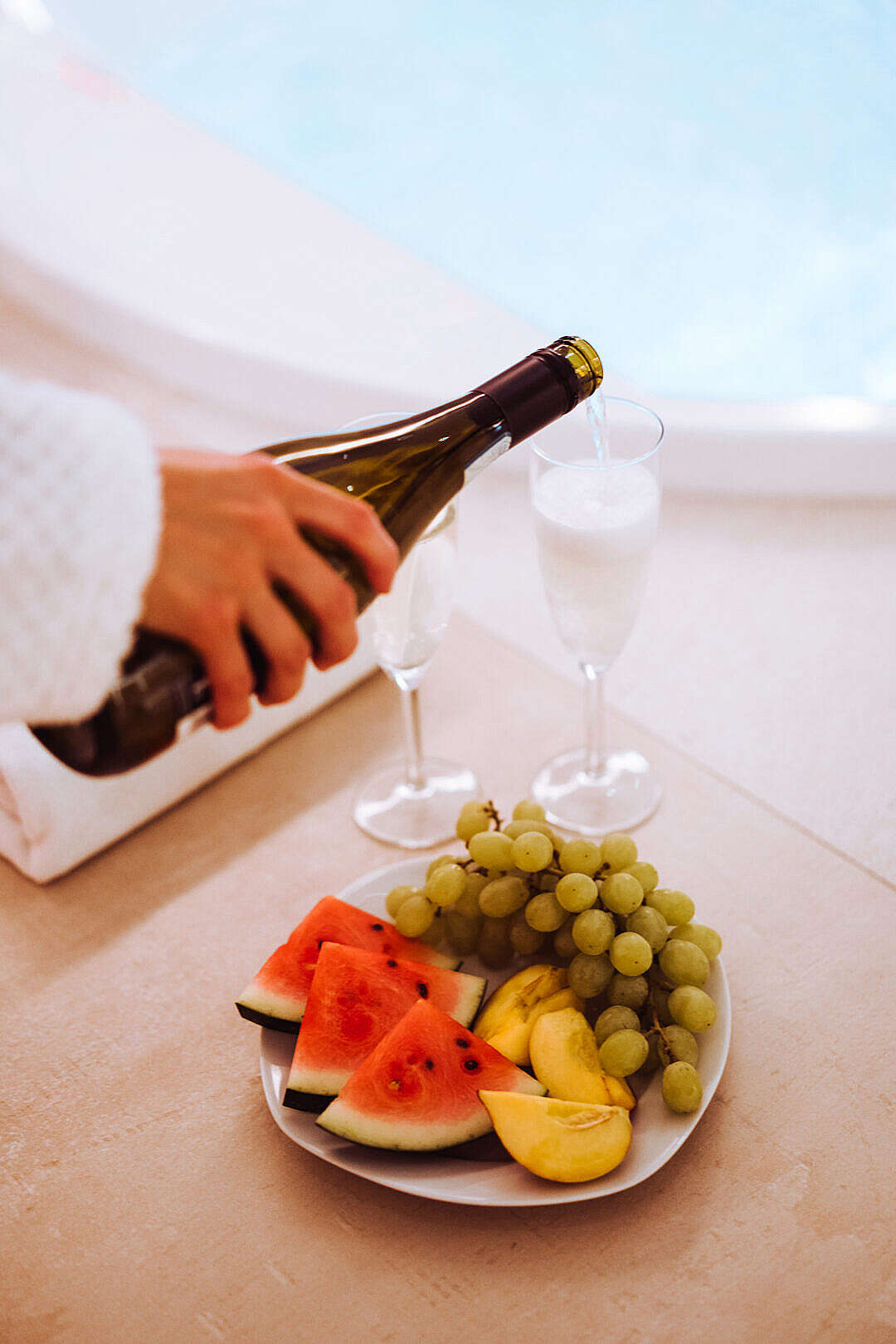 Download Person Pours Prosecco in Spa Wellness FREE Stock Photo
