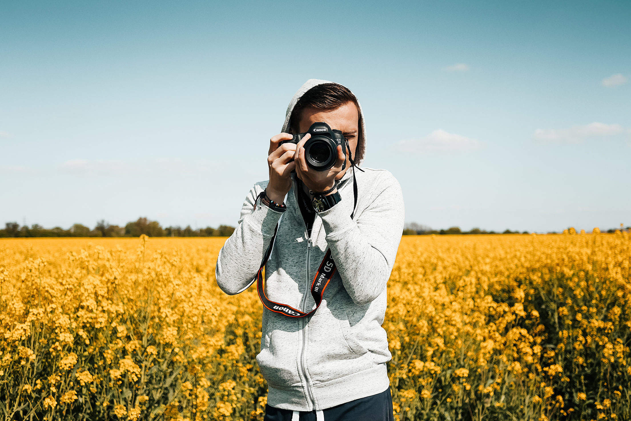 Photographer Taking a Photo in The Field Free Stock Photo