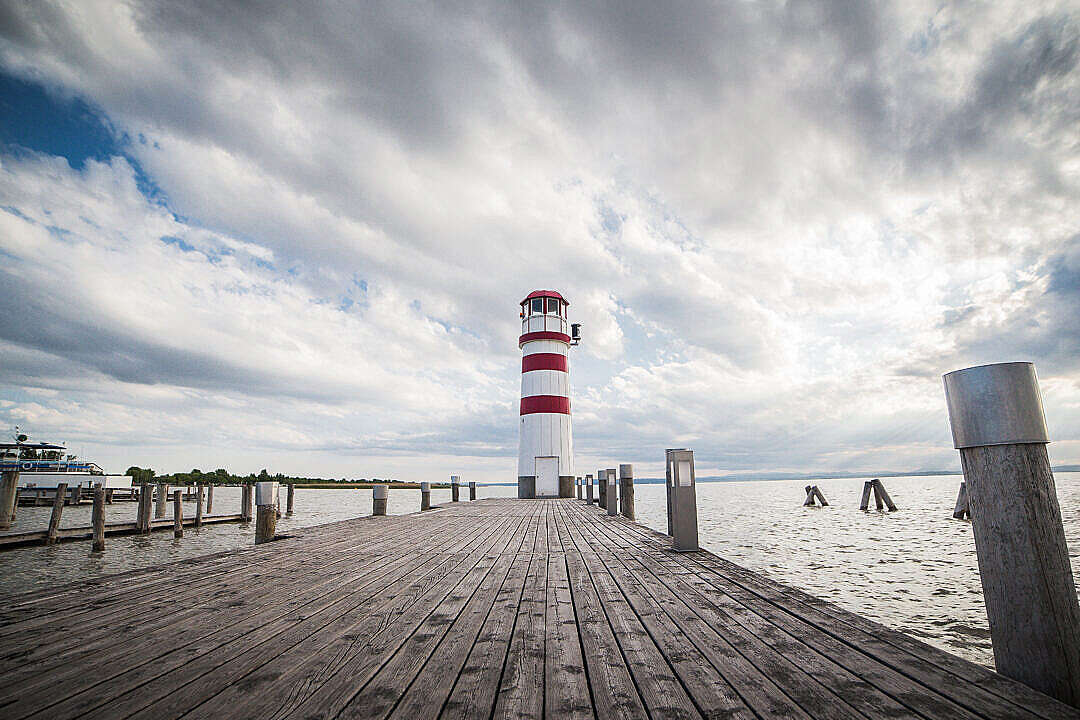 Download Pier with a Beautiful Lighthouse FREE Stock Photo