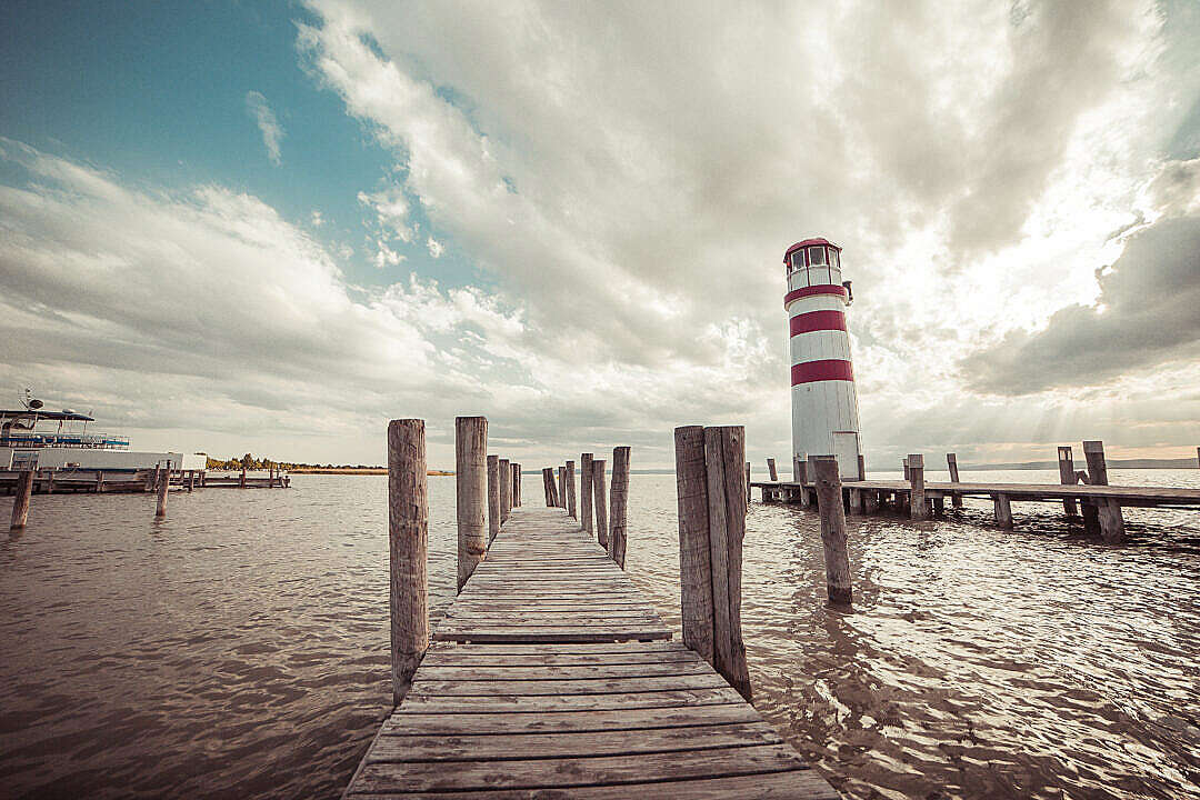 Download Pier with a Lighthouse: Vintage Edit FREE Stock Photo