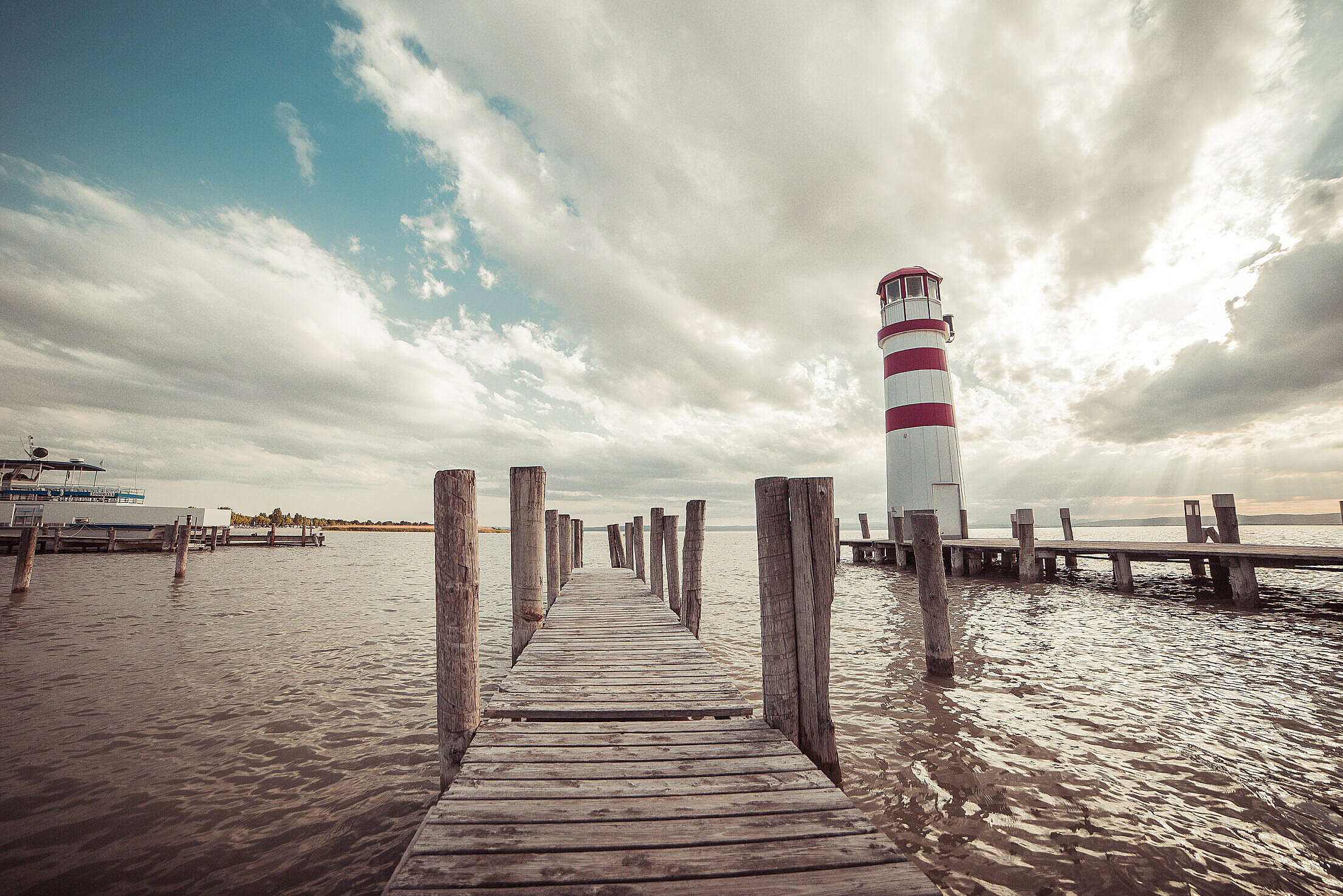 Pier with a Lighthouse: Vintage Edit Free Stock Photo