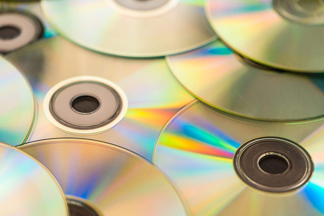 Download Pile of CD Compact Discs and DVDs FREE Stock Photo