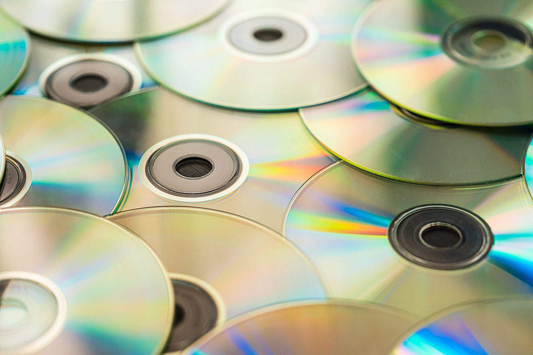 Download Pile of CD Compact Discs and DVDs #2 FREE Stock Photo