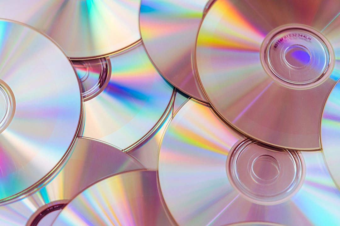 Download Pile of CDs Compact Discs and DVDs FREE Stock Photo