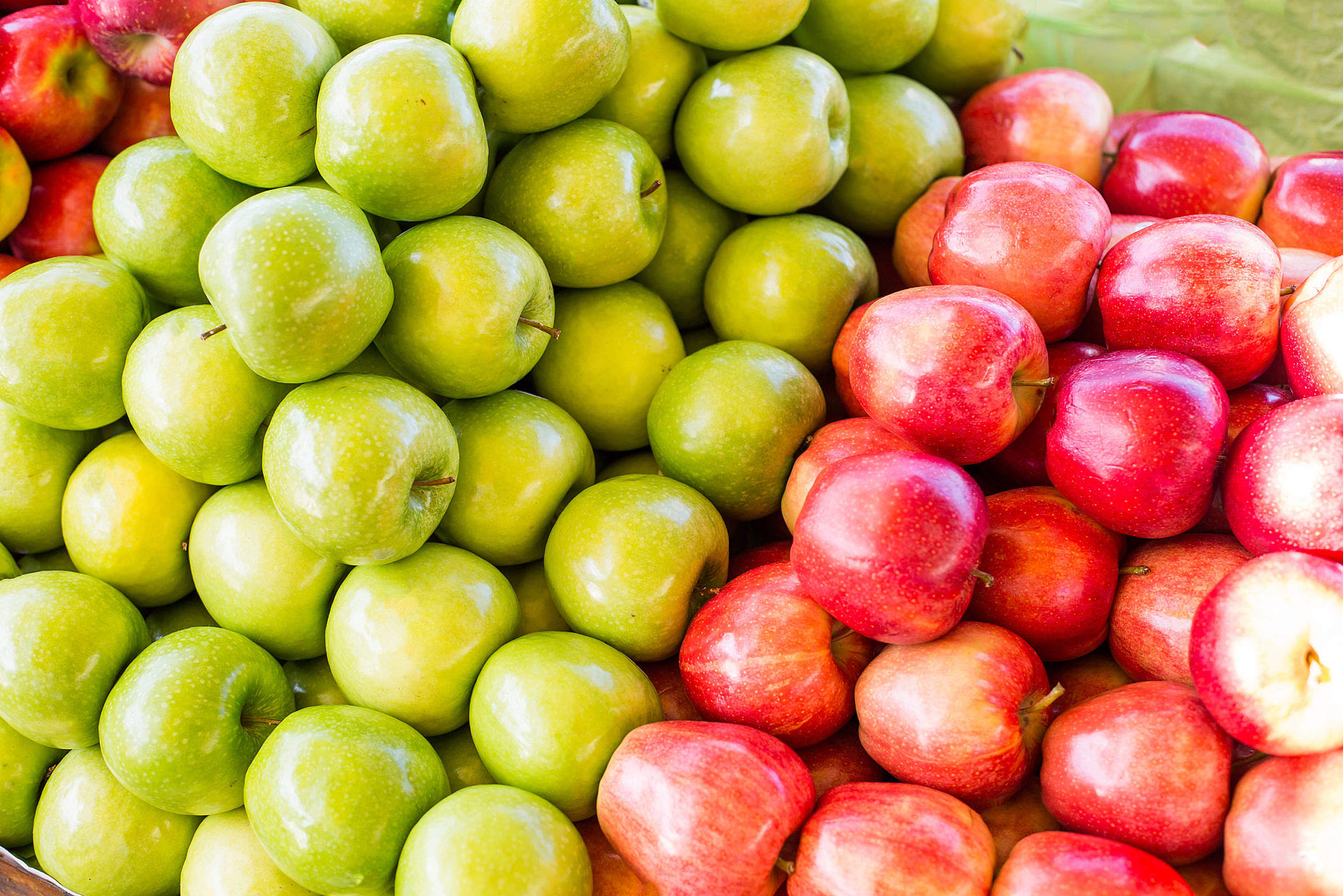 Pile of Gala and Granny Smith Apples on Market Free Stock Photo