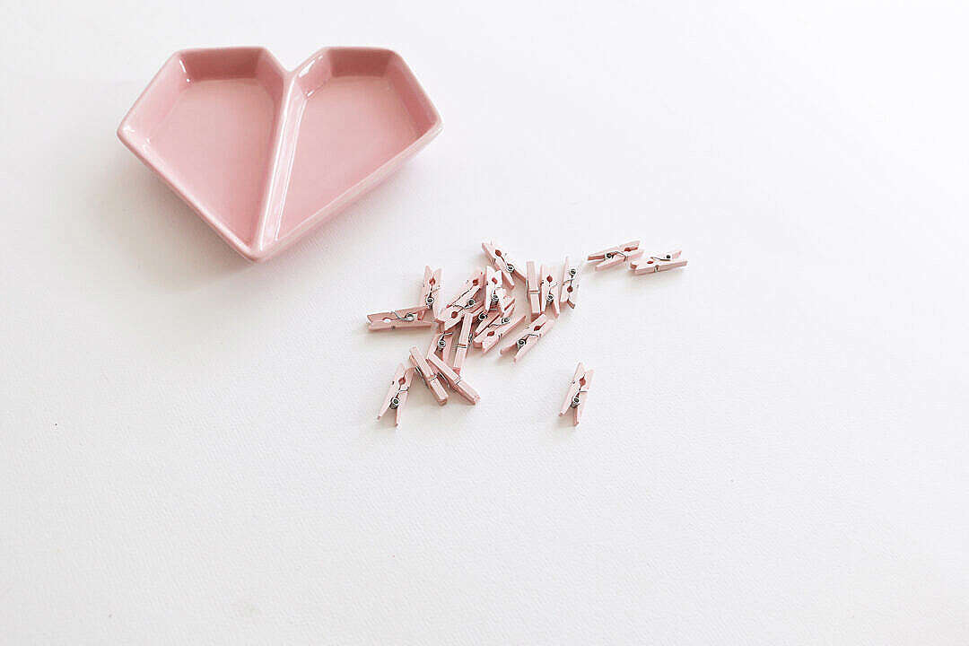 Download Pink Heart-Shaped Plate with Mini Wooden Pegs FREE Stock Photo