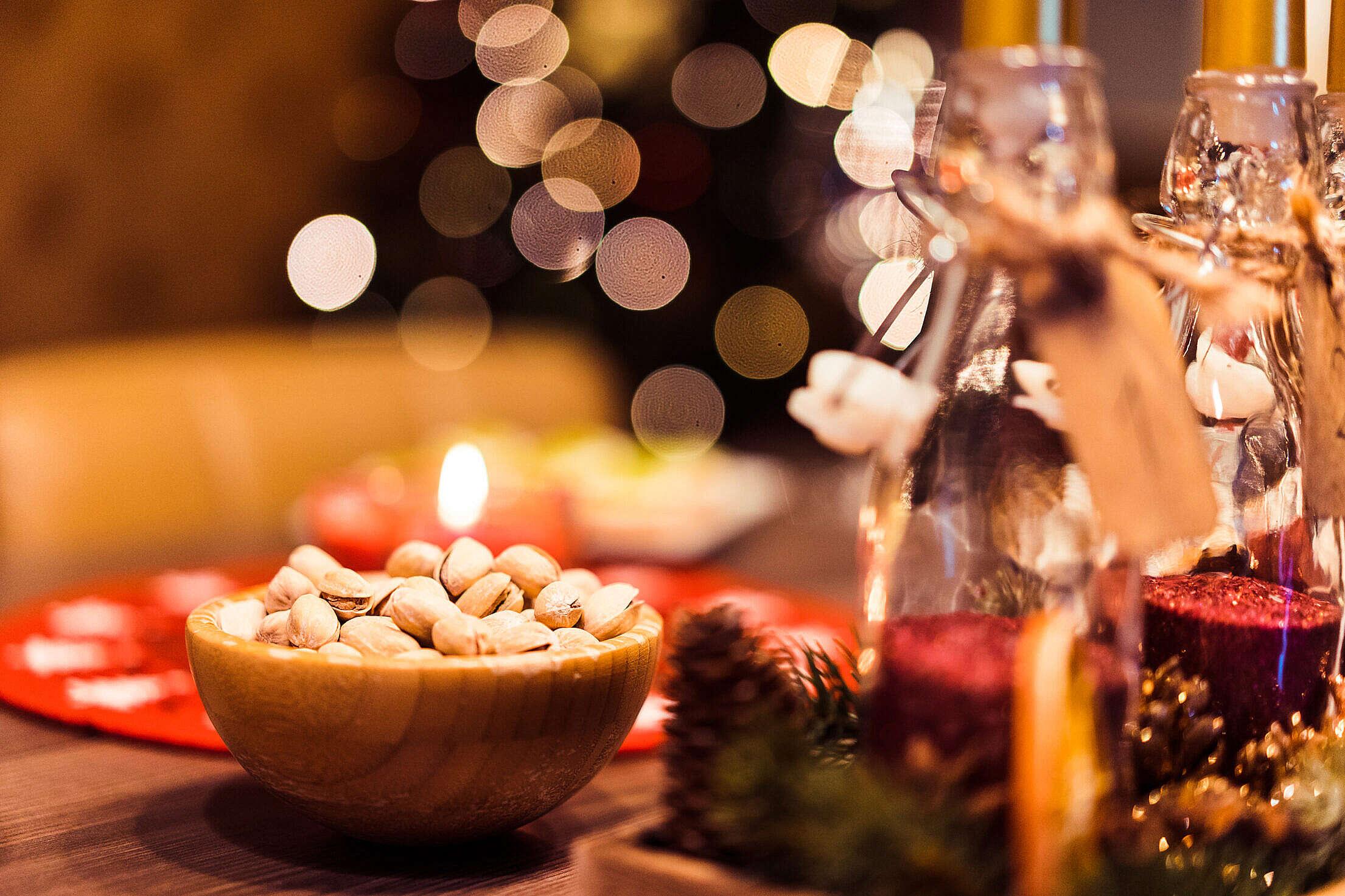 Pistachio Bowl on Christmas Table Free Stock Photo