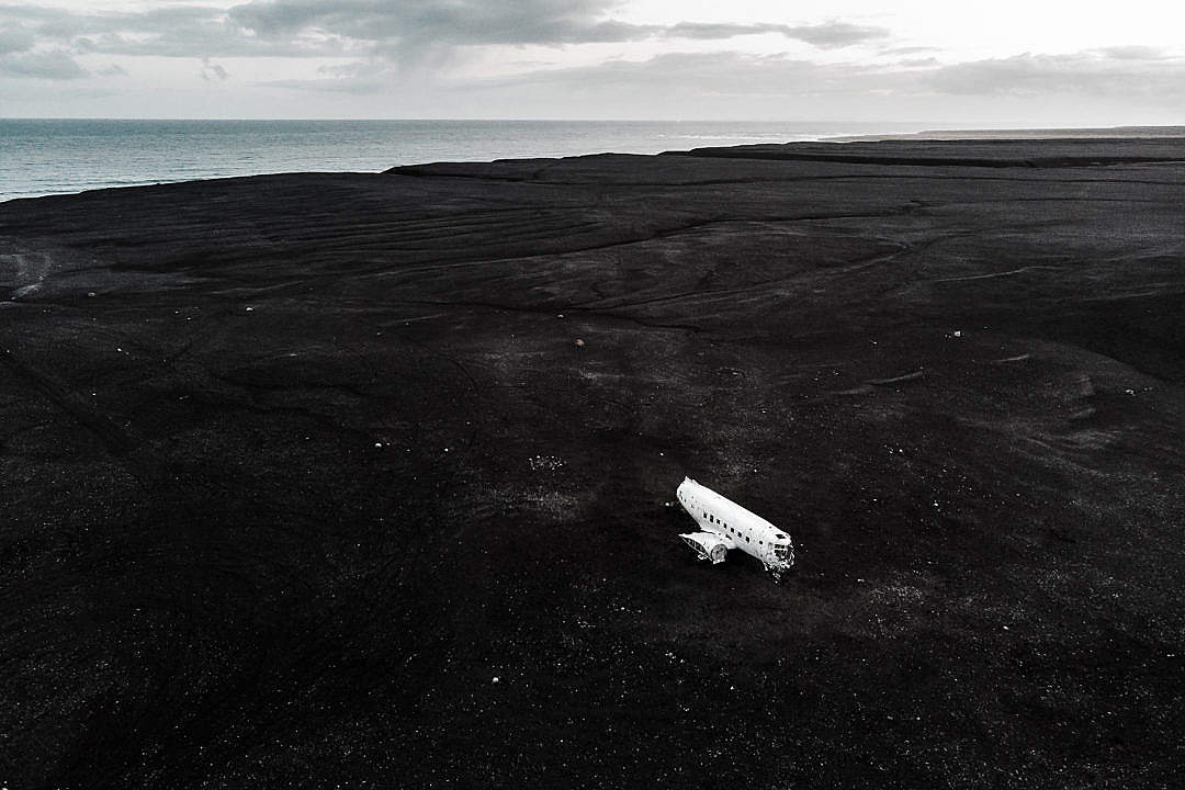 Download Plane on The Black Sand in Iceland FREE Stock Photo