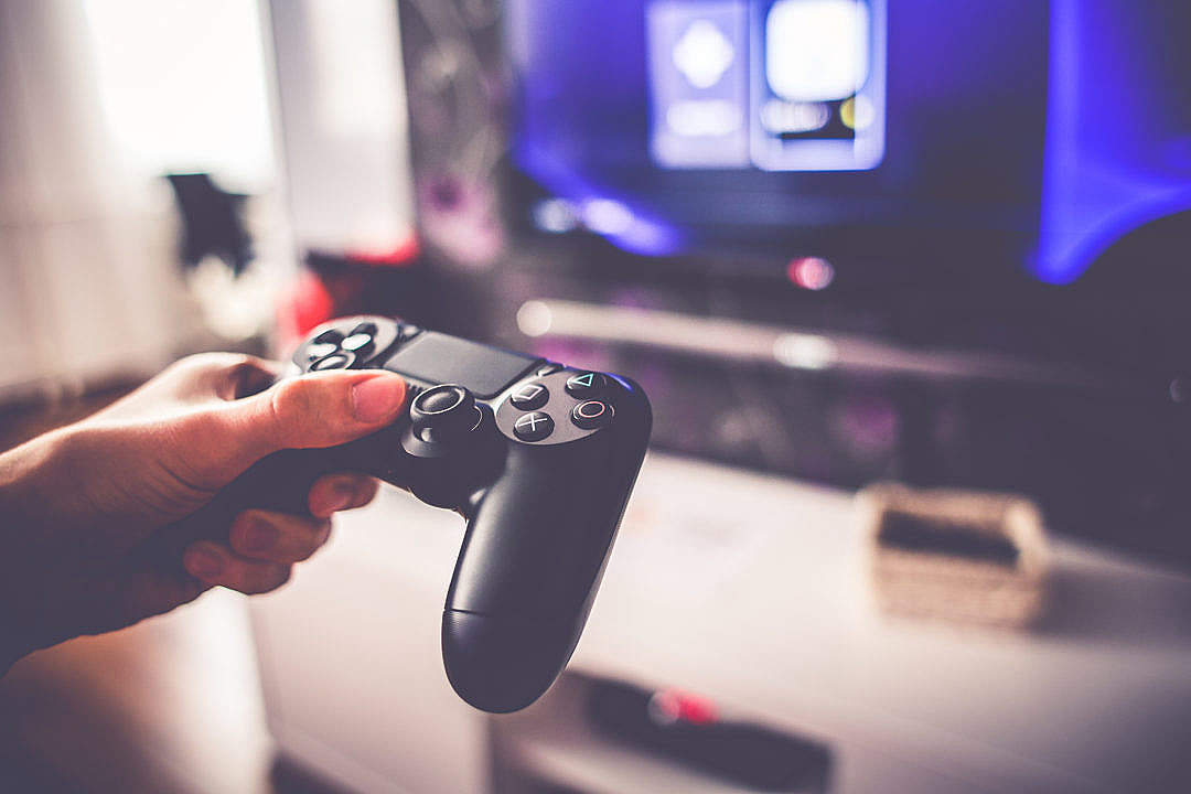 Download Playing Games on Playstation 4 FREE Stock Photo
