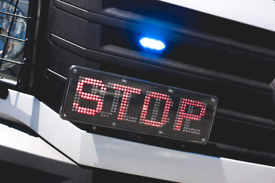 Download Police Flashing Light and STOP Sign on Car FREE Stock Photo
