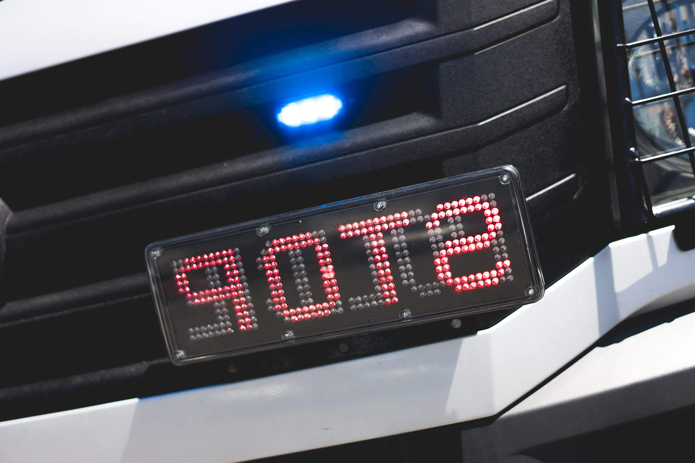 Police Flashing Light and STOP Sign on Car Mirrored Free Stock Photo