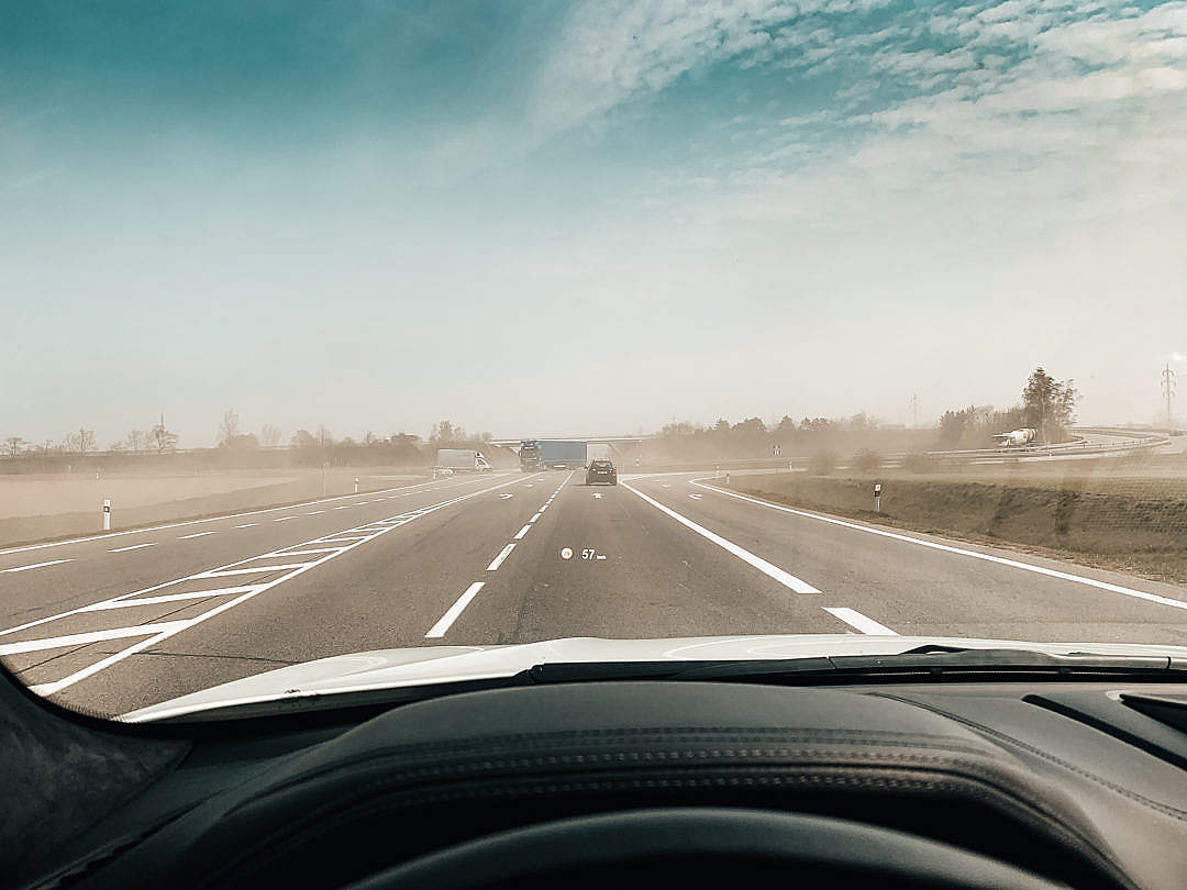 Download POV Driving a Car Through Dust From Fields FREE Stock Photo