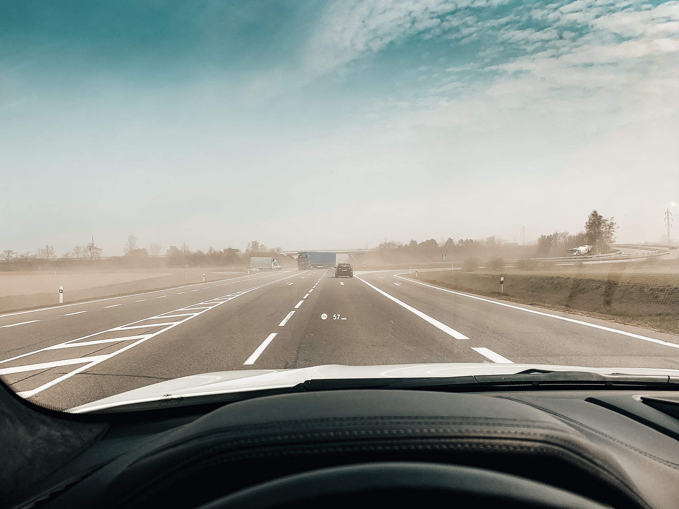 POV Driving a Car Through Dust From Fields Free Stock Photo