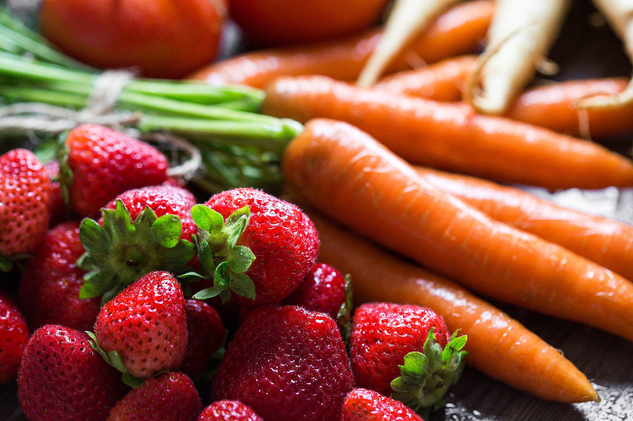 Preparing Fresh Breakfast: Strawberries & Carrots Free Stock Photo