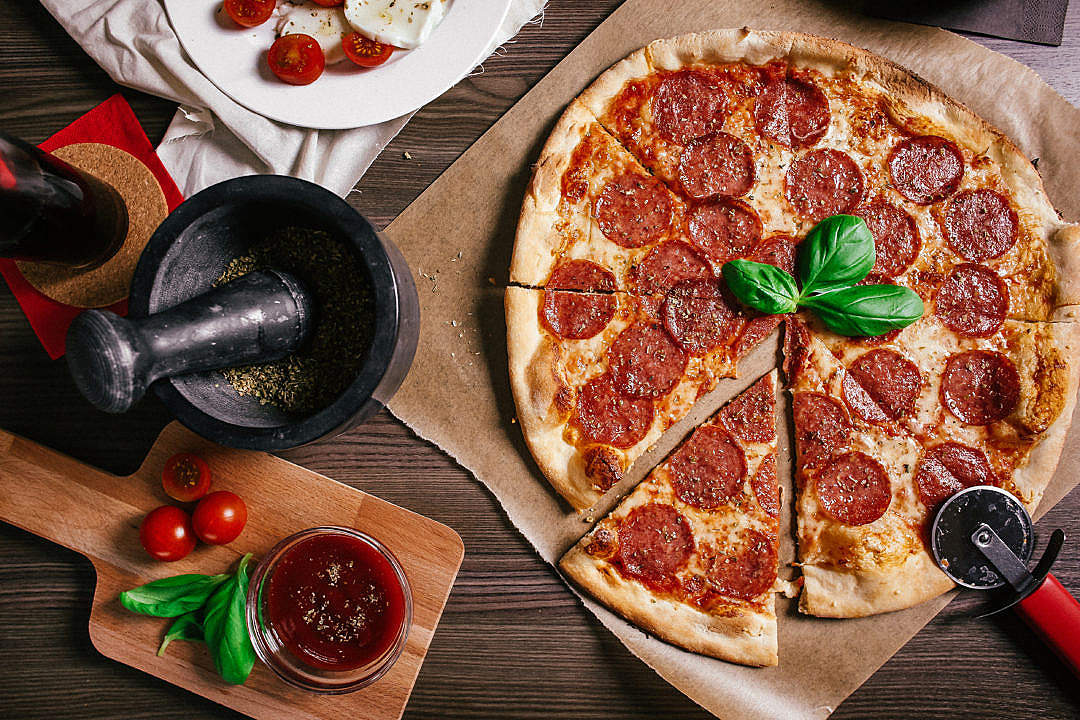 Download Preparing Salami Pizza FREE Stock Photo