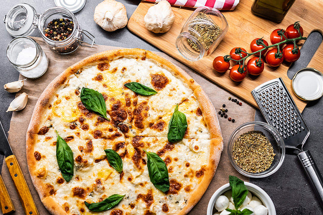 Download Quattro Formaggi Pizza FREE Stock Photo