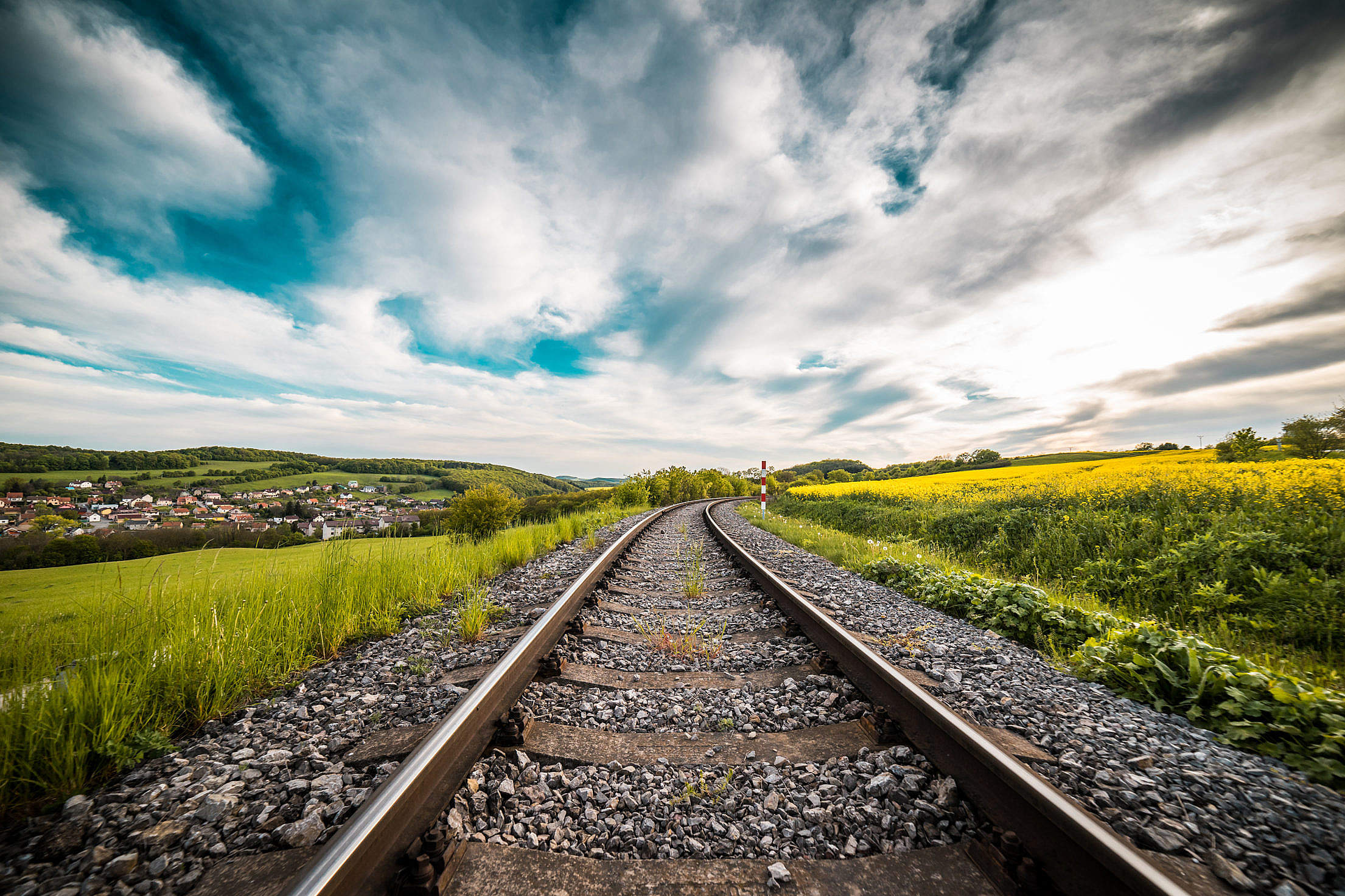 Railway Road in The Middle of a Field Free Stock Photo