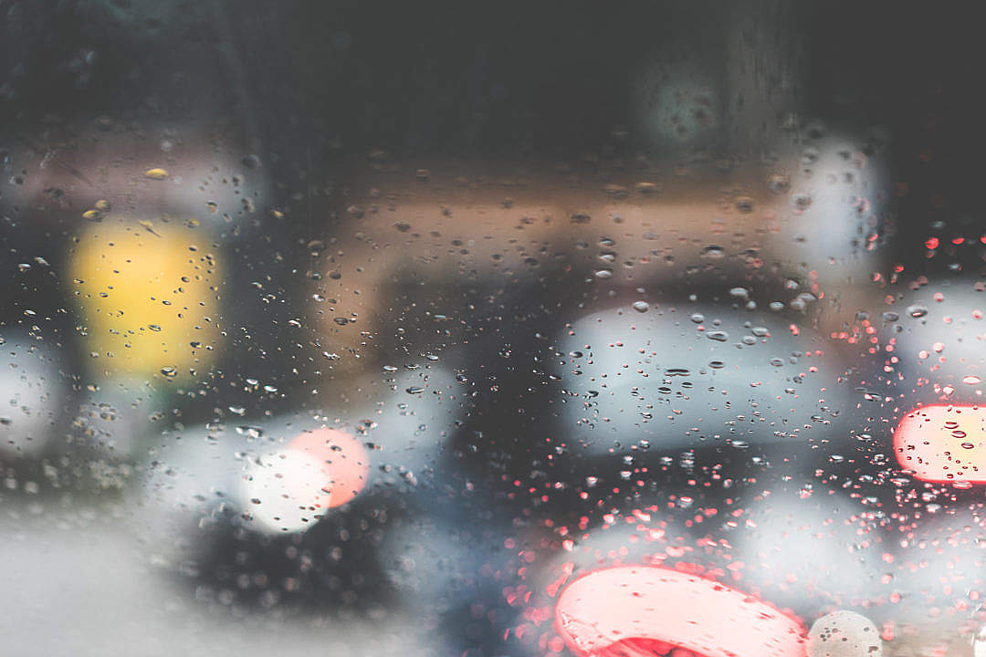 Download Rain Drops on a Car Windshield in a Rainy Day FREE Stock Photo