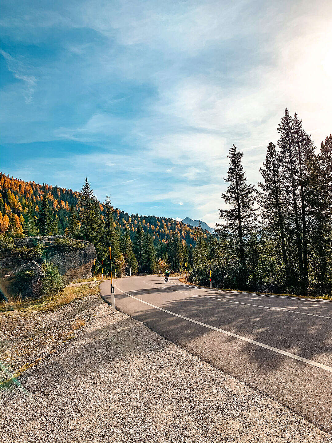 Download Random Road with a Cyclist in Dolomites, Italy FREE Stock Photo
