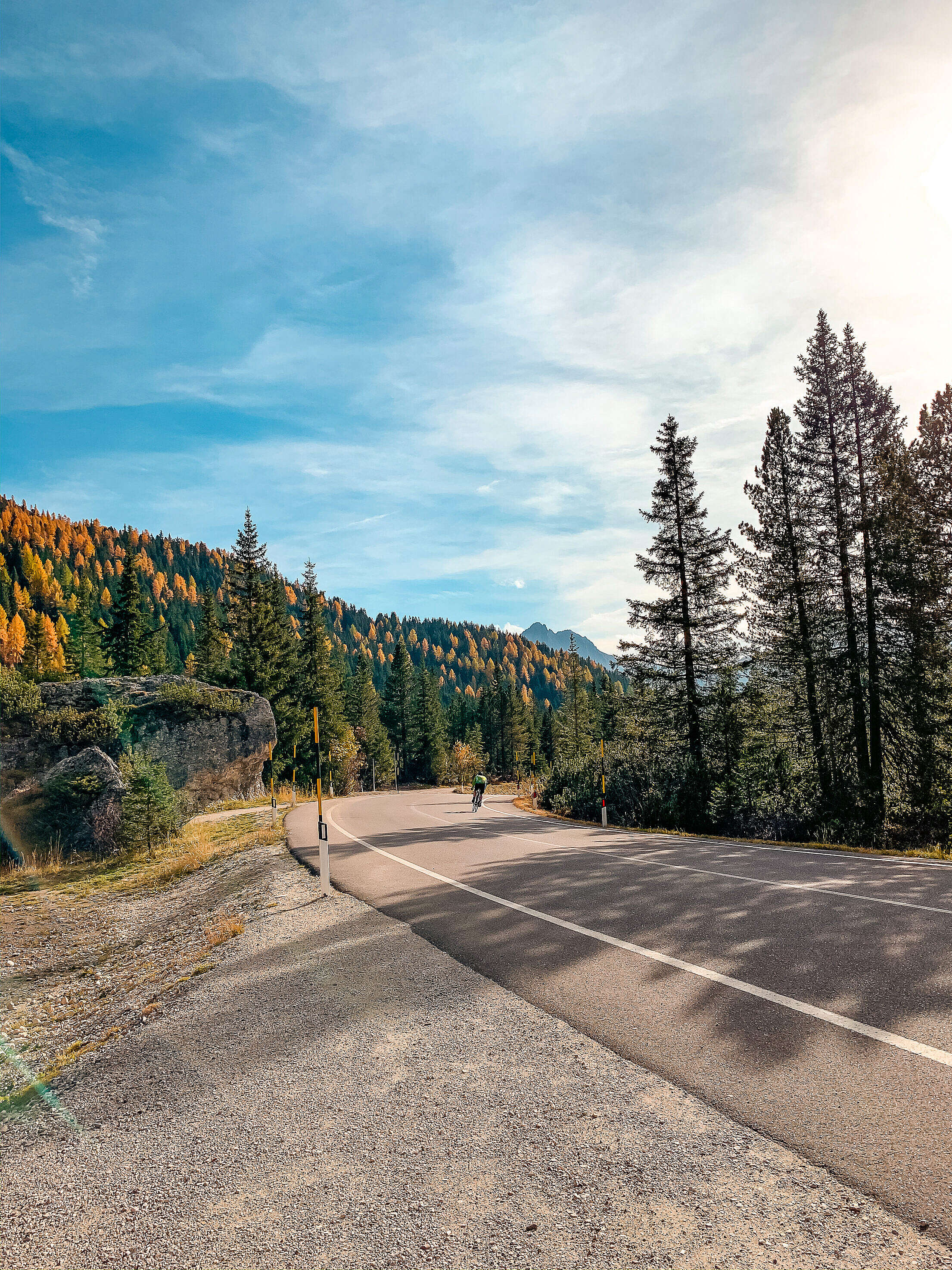 Random Road with a Cyclist in Dolomites, Italy Free Stock Photo