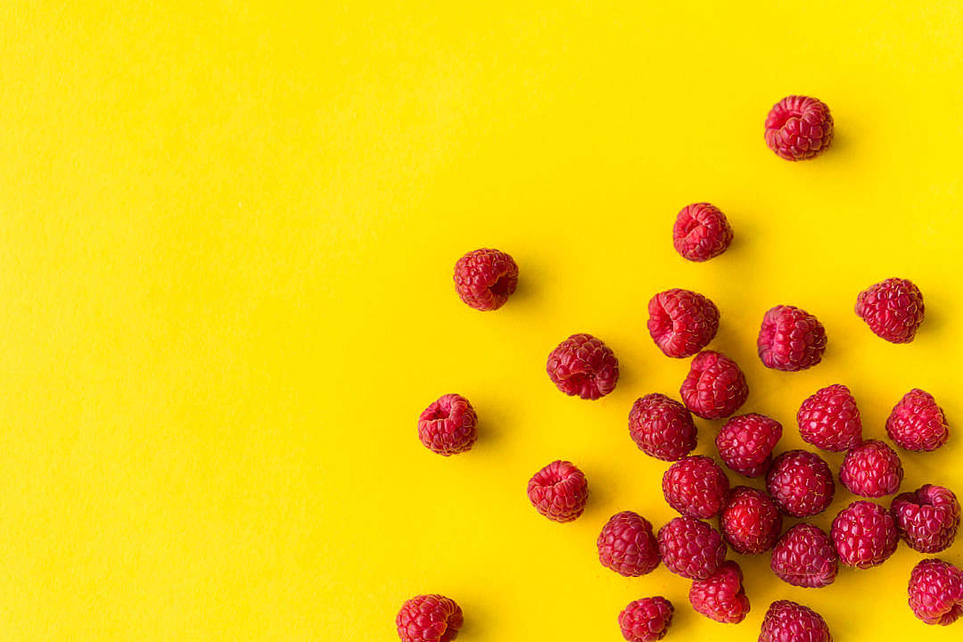 Download Raspberries on Flat Yellow Background FREE Stock Photo