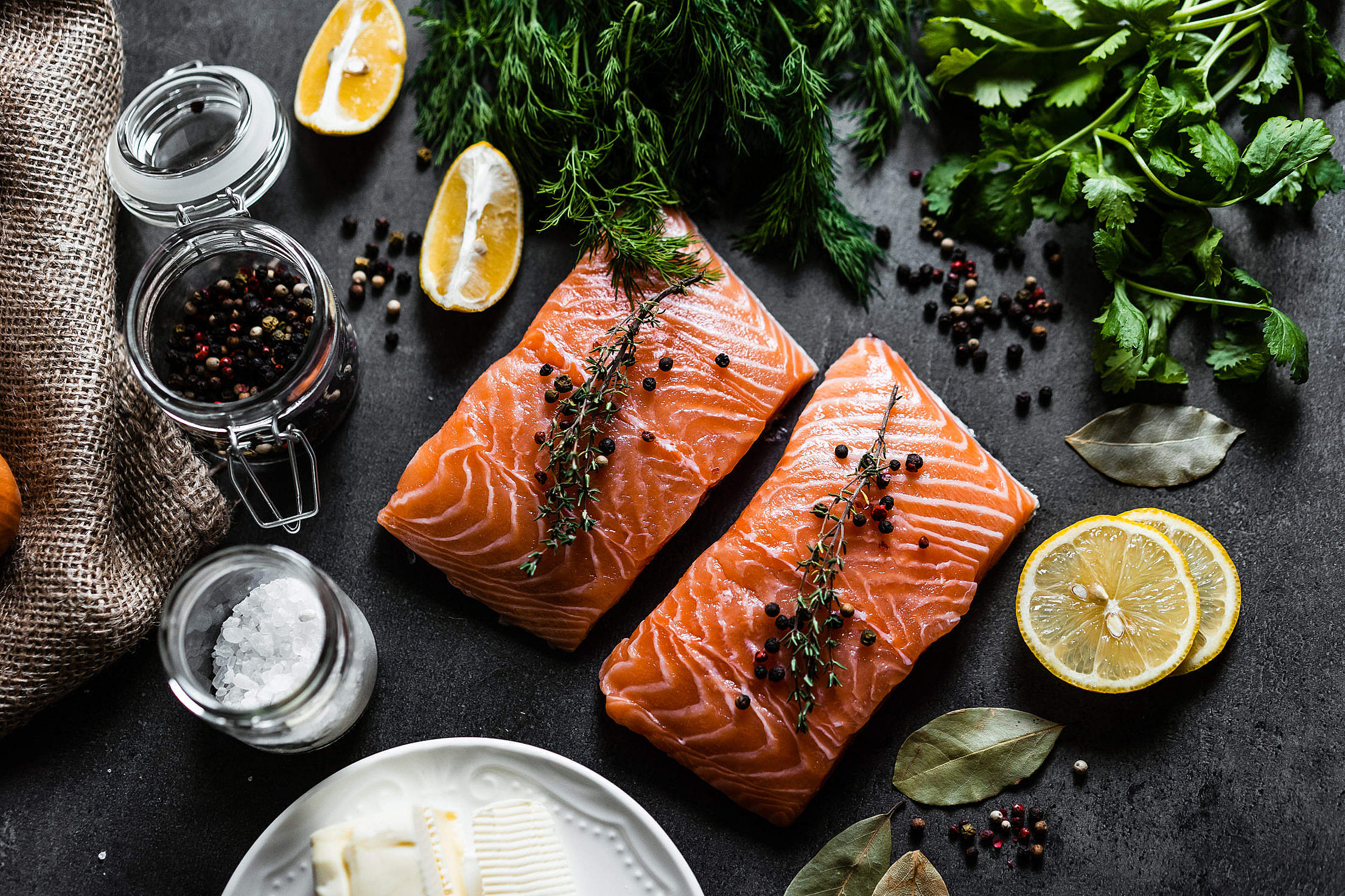 Raw Salmon Fillets and Ingredients for Cooking Free Stock Photo