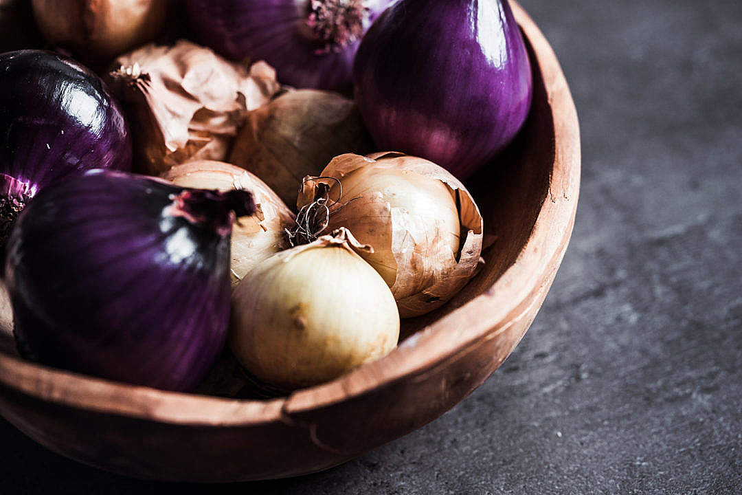 Download Red and Yellow Onions in a Wooden Bowl FREE Stock Photo