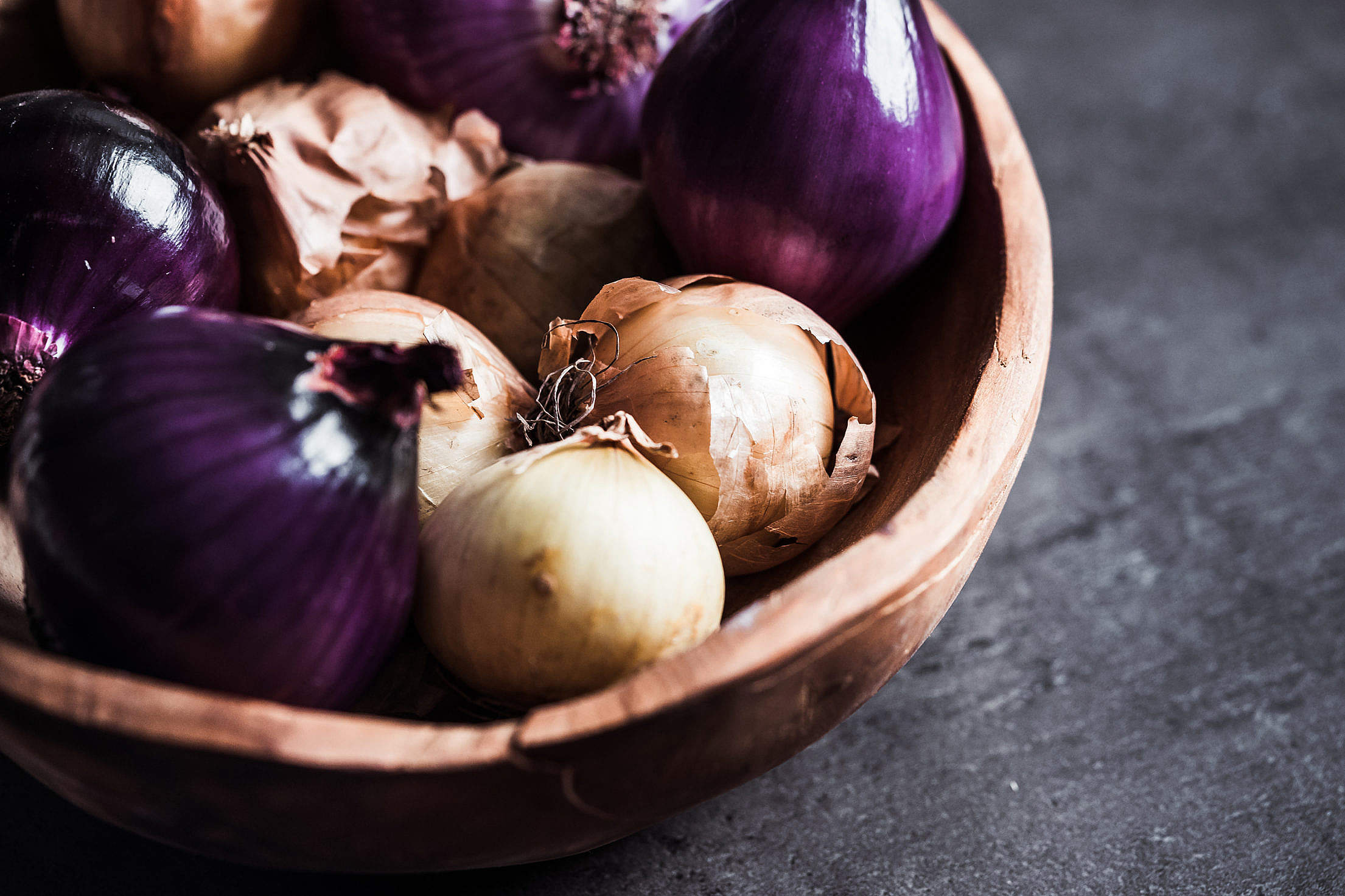 Red and Yellow Onions in a Wooden Bowl Free Stock Photo