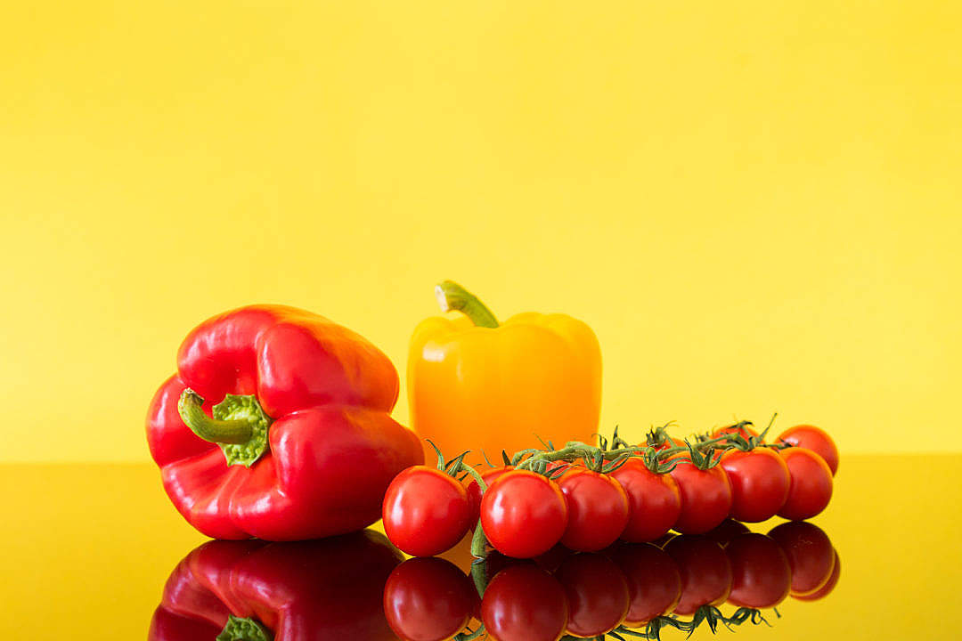 Download Red and Yellow Paprikas with Tomatoes Still Life FREE Stock Photo