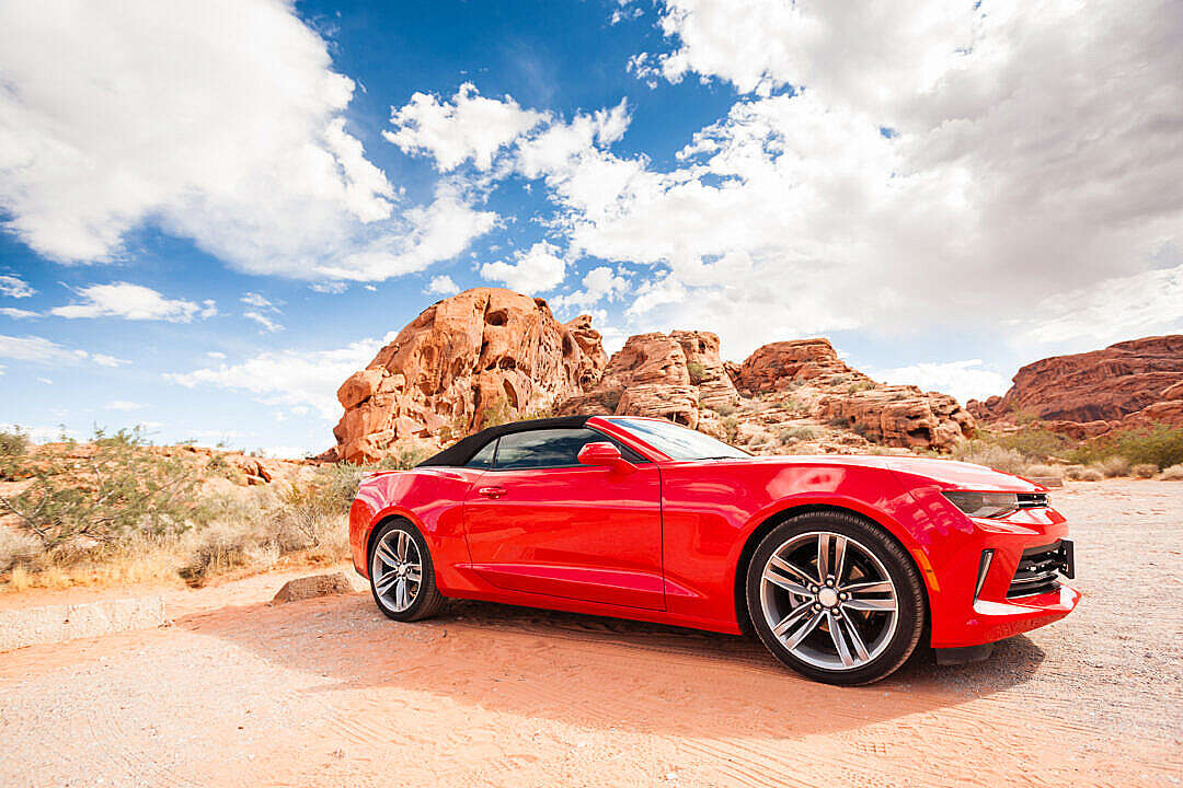 Download Red Convertible in a National Park FREE Stock Photo