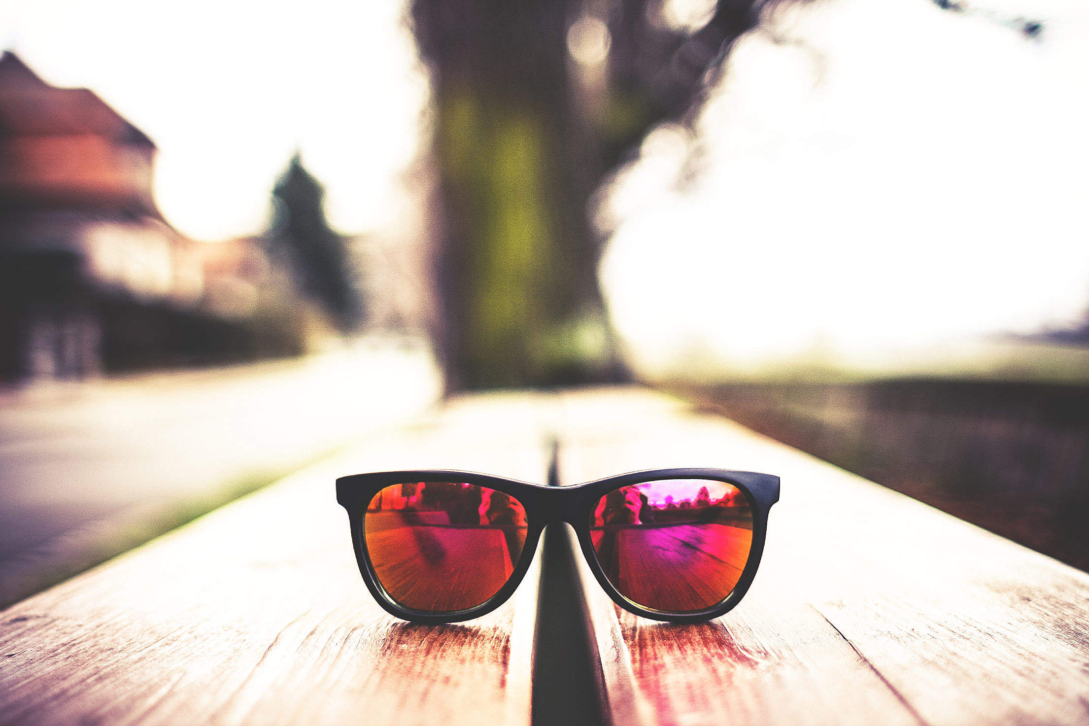 Red Fashion Glasses on Wooden Table Free Stock Photo
