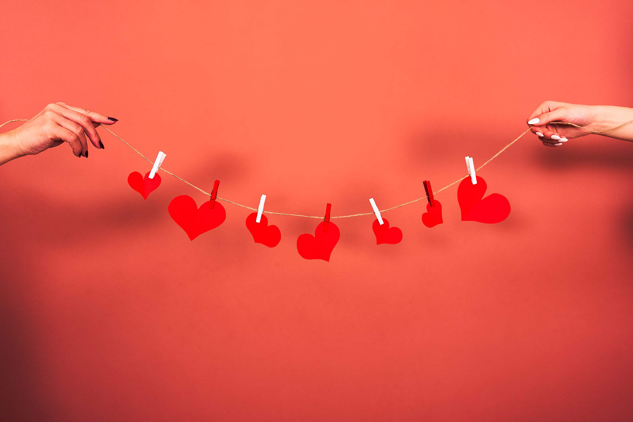 Red Hearts Hanging on a String Free Stock Photo