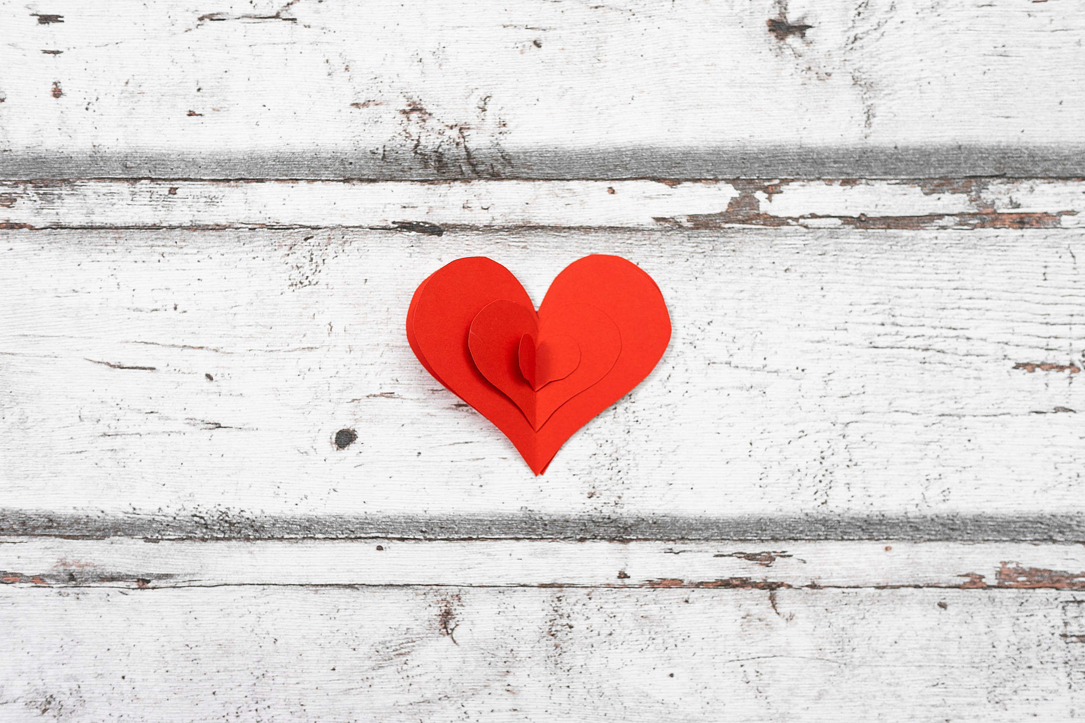 Red Paper Heart on a White Wooden Background Free Stock Photo