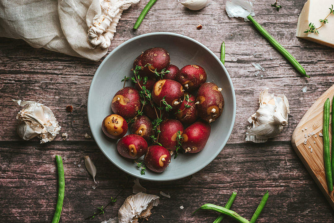Download Red Potatoes with Thyme on a Rustic Table FREE Stock Photo
