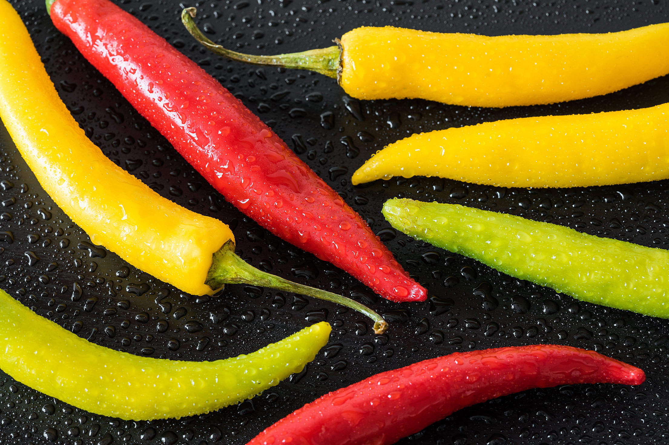 Red, Yellow and Green Colorful Chilli Peppers Free Stock Photo