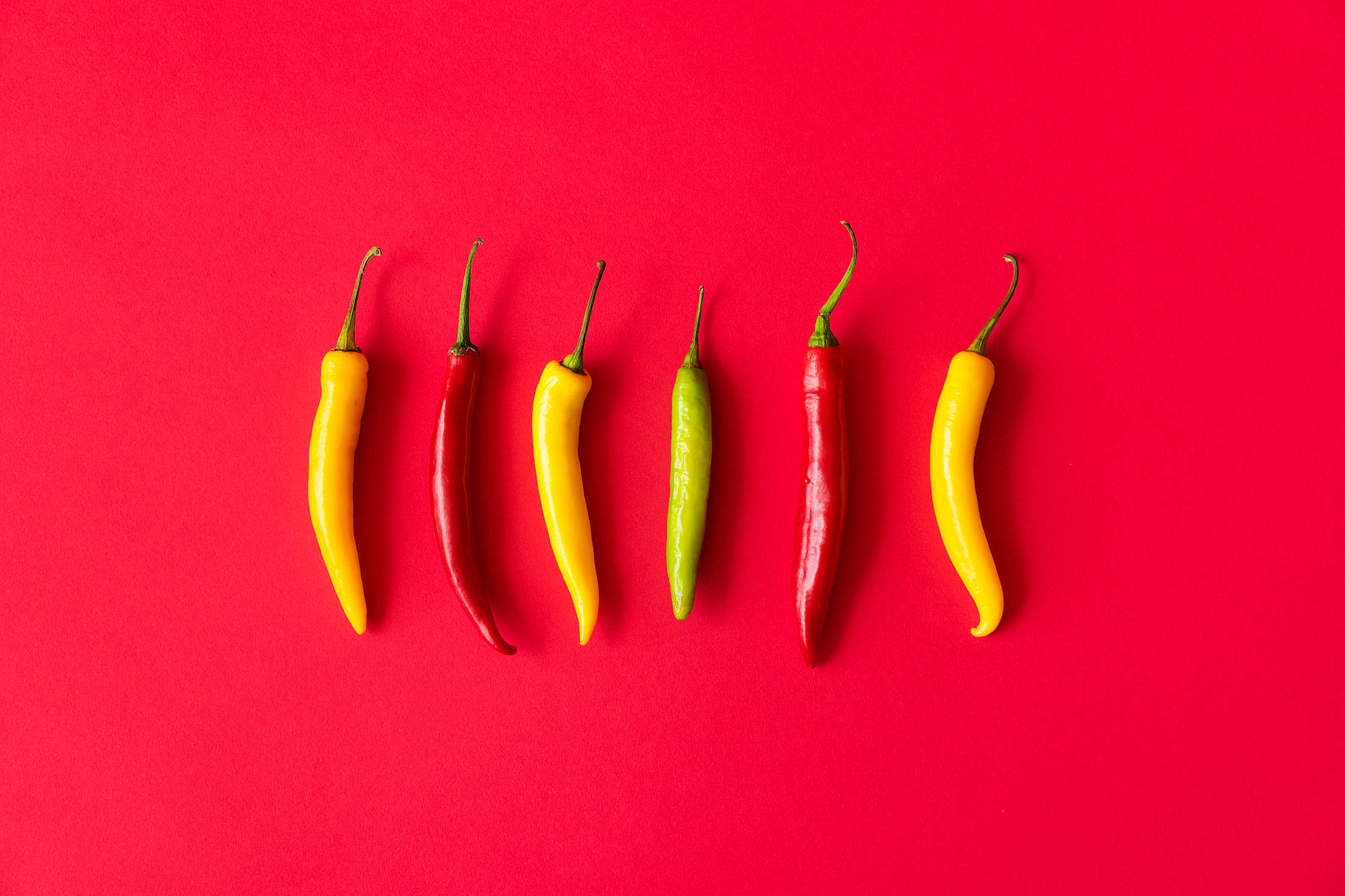 Red, Yellow and Green Hot Chilli Peppers Free Stock Photo