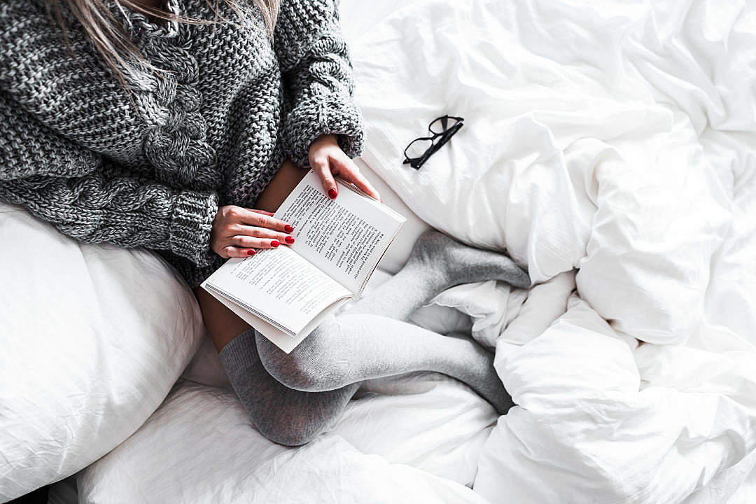 Download Relaxed Woman Reading in Bed FREE Stock Photo