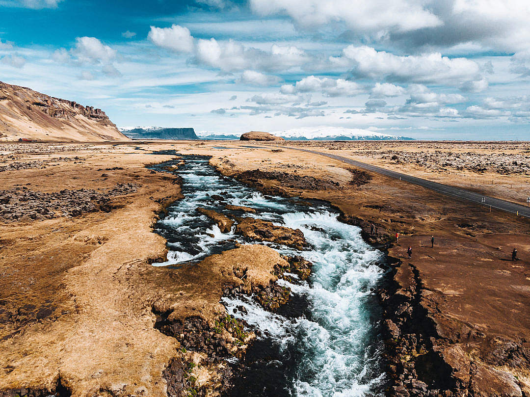 Download River and Small Waterfalls Along the Road on Iceland FREE Stock Photo
