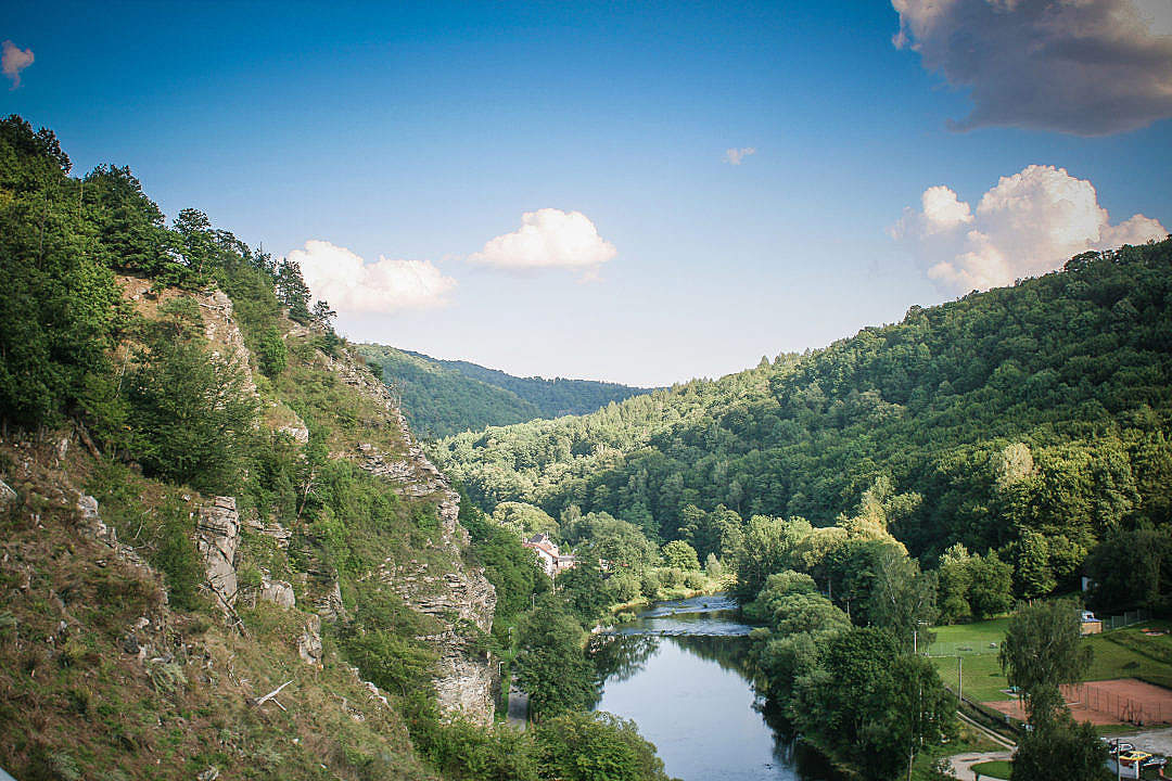 Download River Between Vranov Mountains FREE Stock Photo