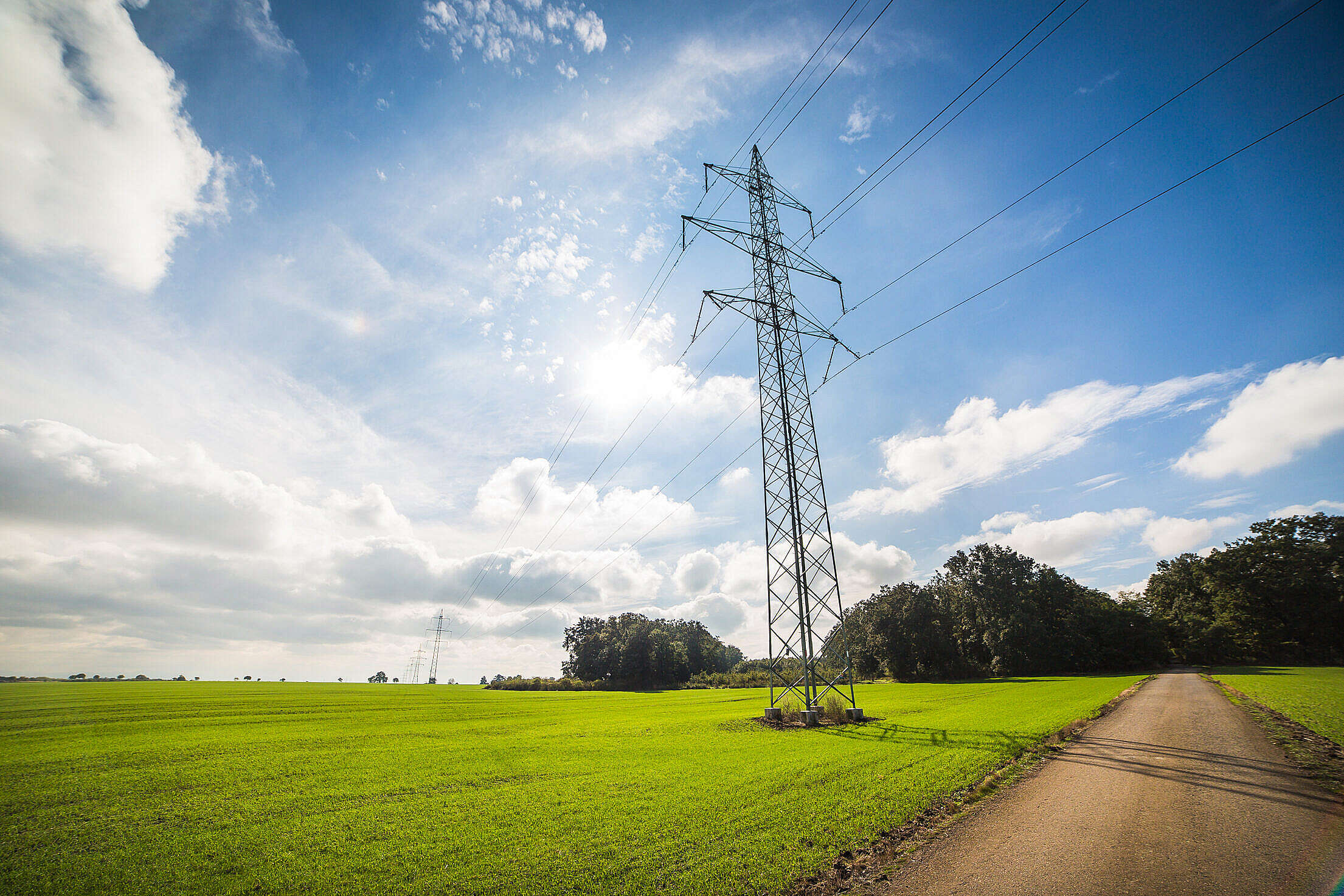Road Under Power Line Electricity Pylons Free Stock Photo