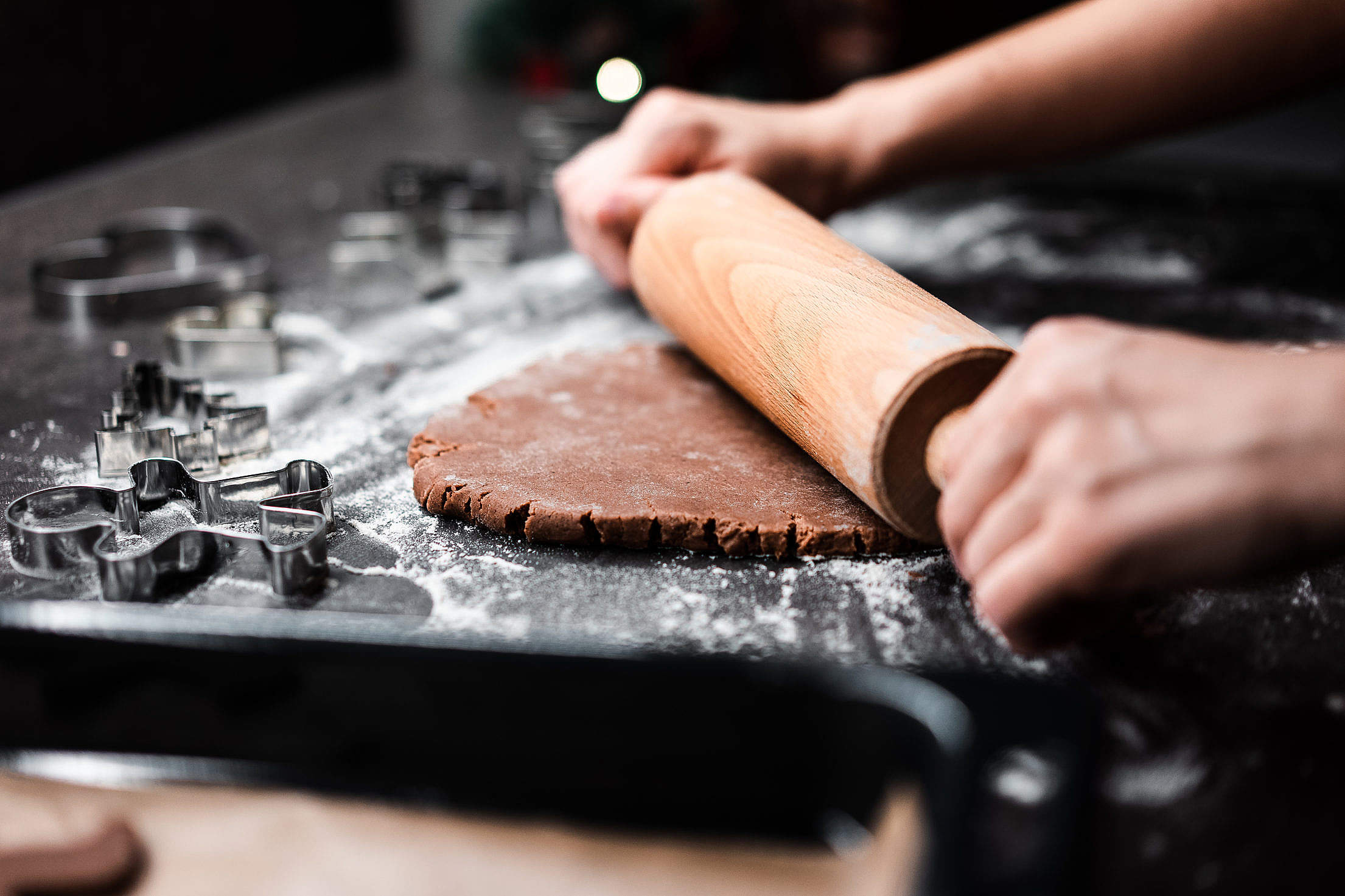 Rolling Homemade Gingerbread Dough for Christmas Biscuits Free Stock Photo