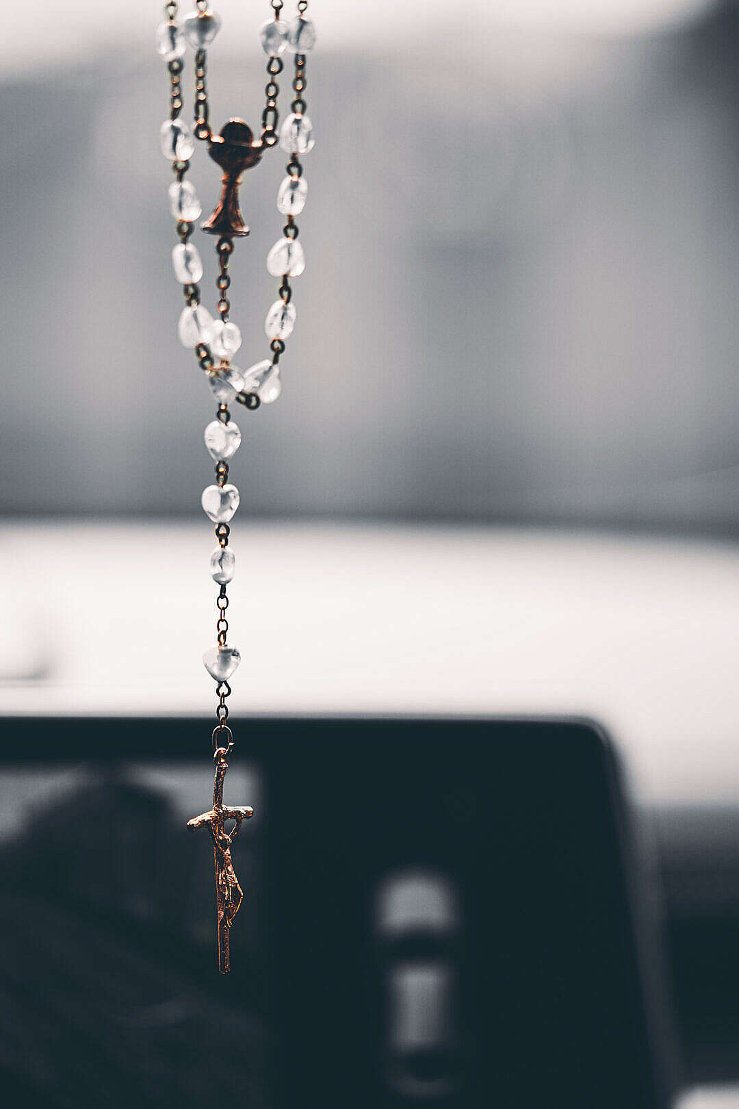 Download Rosary Christian Cross Hanging on the Mirror in the Car FREE Stock Photo