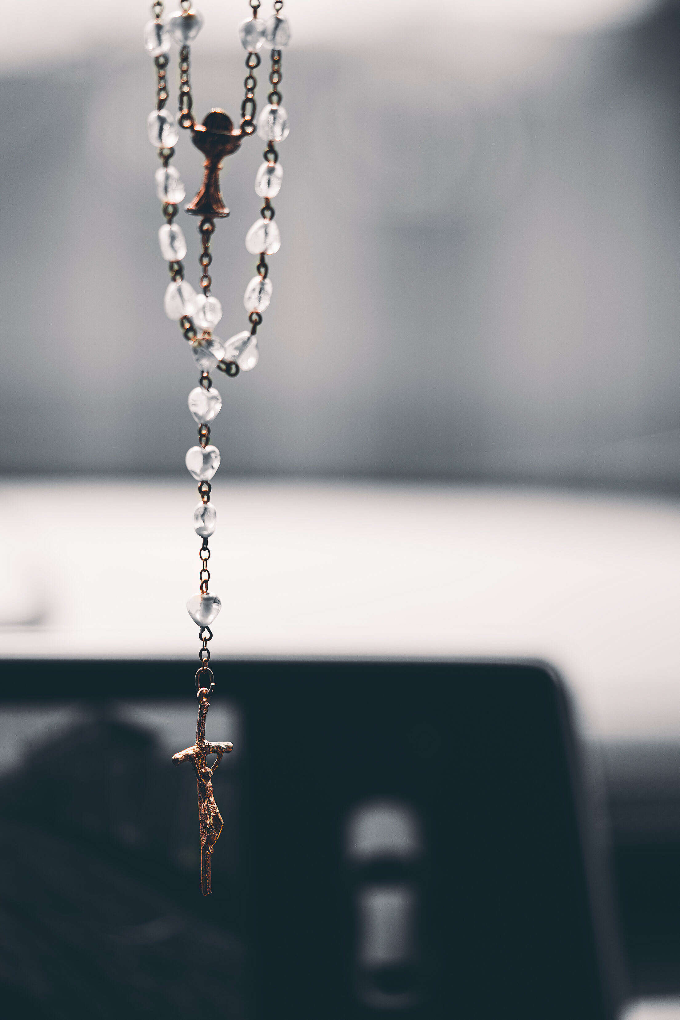 Rosary Christian Cross Hanging on the Mirror in the Car Free Stock Photo