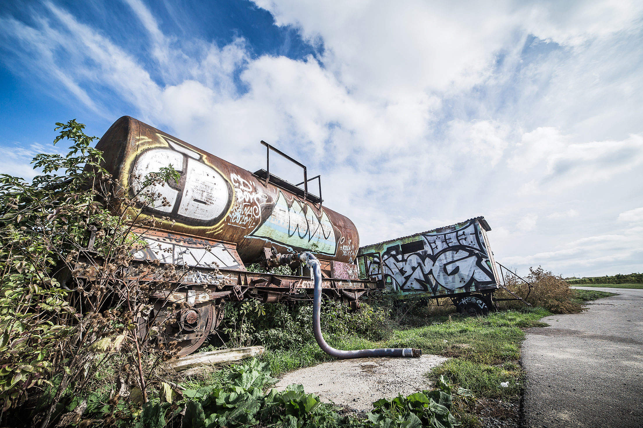 Rusted Wagon with Graffiti Art Alone in The Field Free Stock Photo