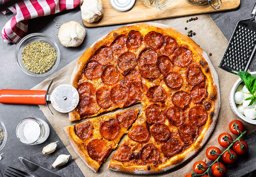 Download Salami Pizza Flatlay FREE Stock Photo
