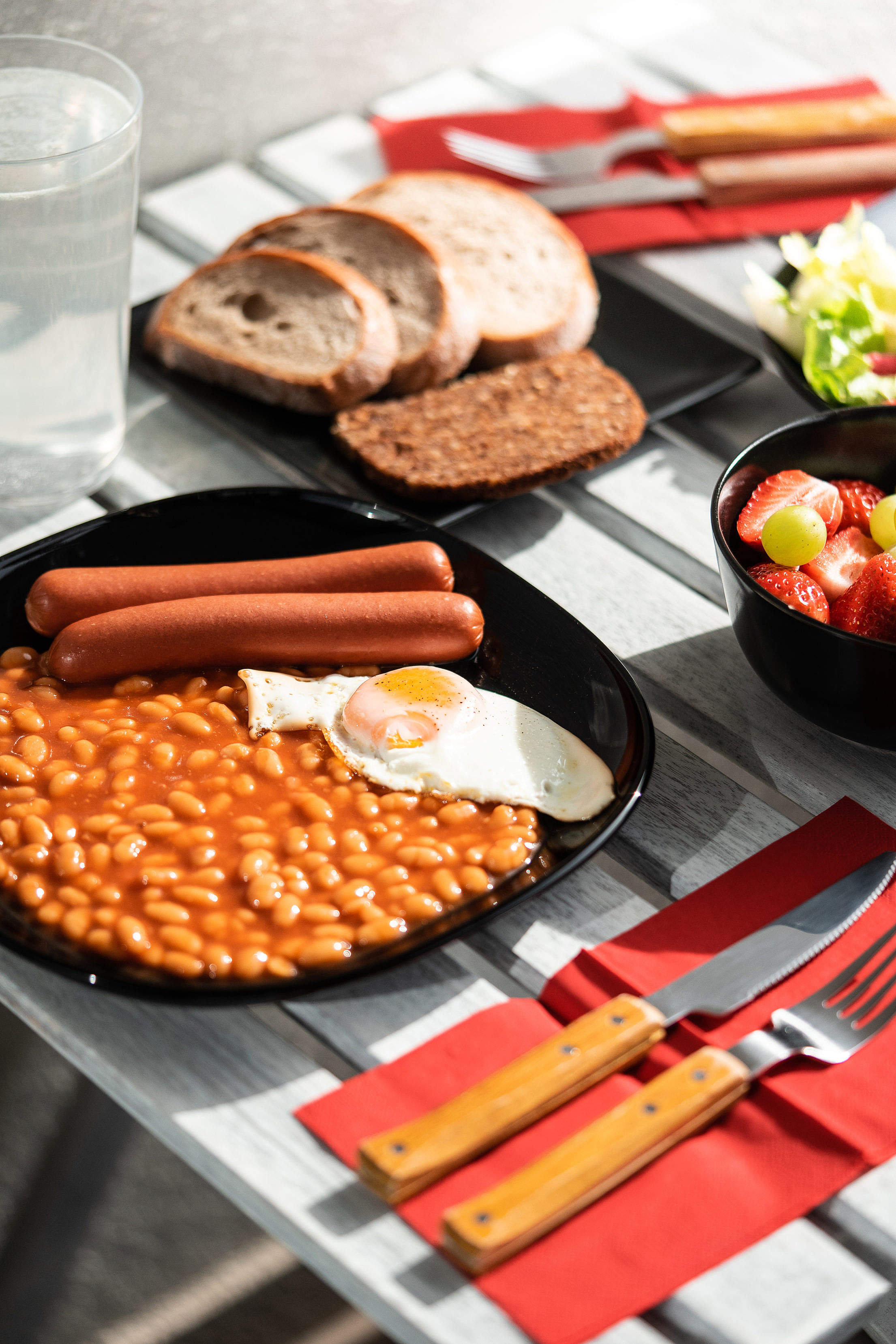Sausages with Beans and Fried Egg Free Stock Photo